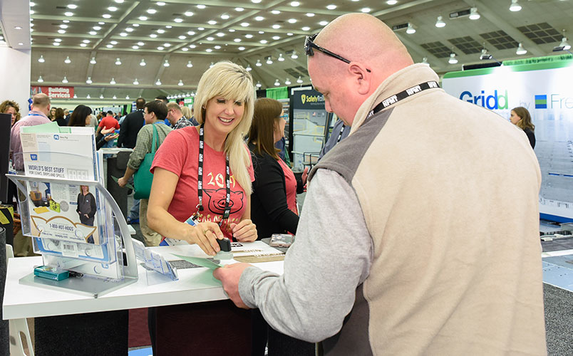 exhibitor and attendee at a booth